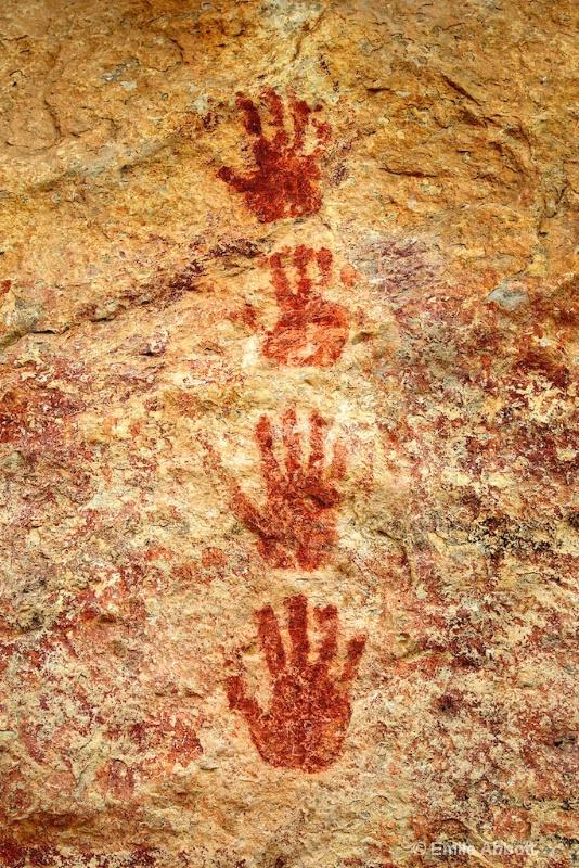 Four vertical positive hand prints
