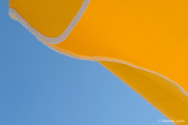 Yellow Umbrella and Blue Sky