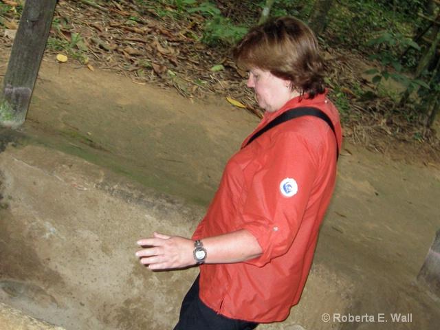 Bonnie entering Cu Chi tunnels