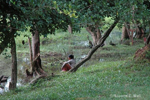 woman fishing in Cambodia