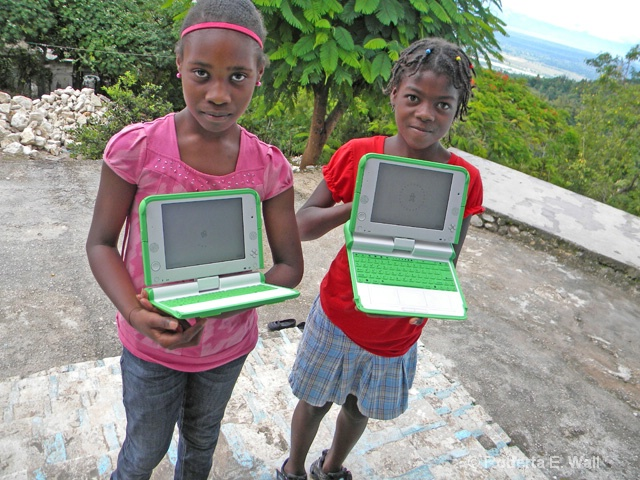 girls in petionville with school computers