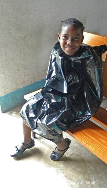 little girl in garbage bag raincoat