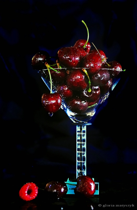 Cherries and a raspberry still life