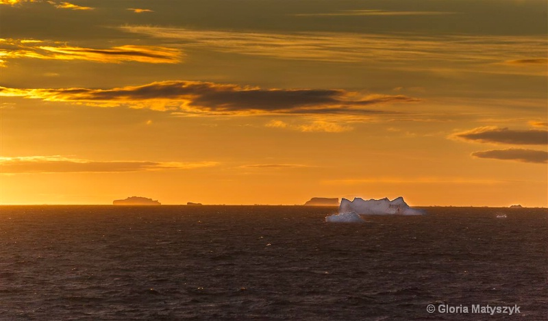 Sunset and iceburgs in Antarctica