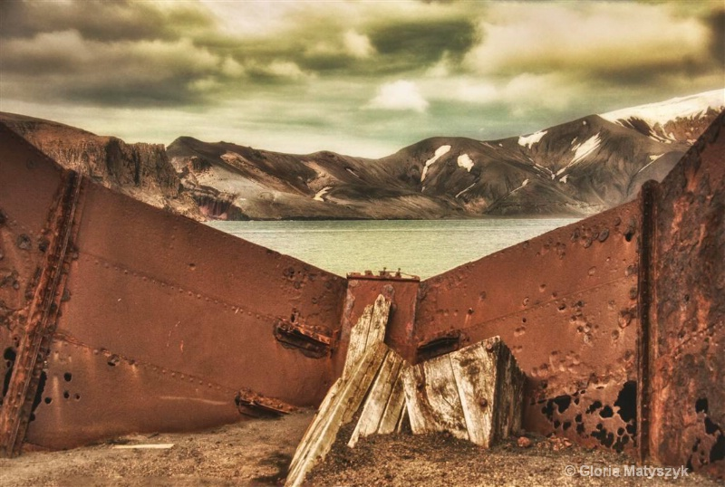 Behind rusted tanks, Antarctica