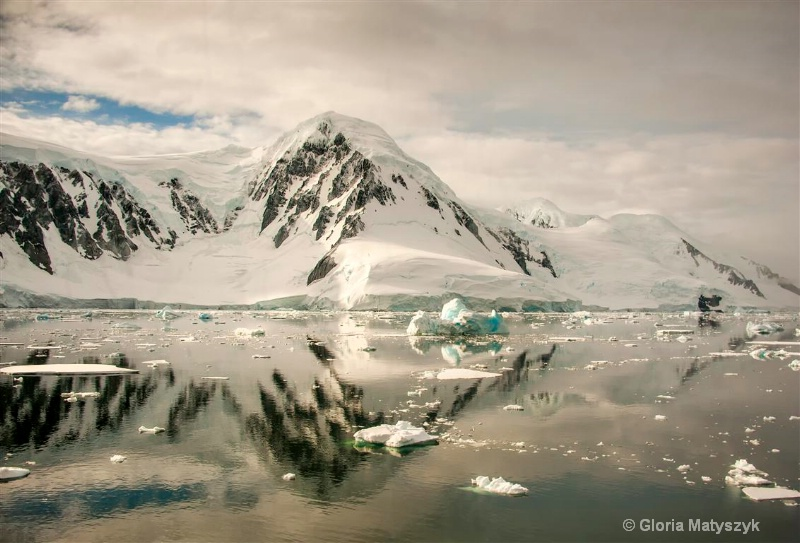 Reflections and grey skies, Antarctica