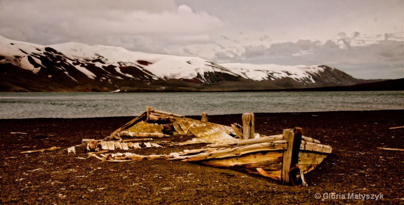 Antarctica landscape with abandoned whaling boat