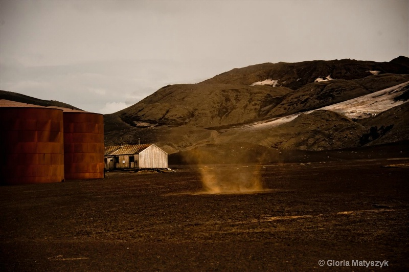 Dust Devil and rusted tanks, Antarctica