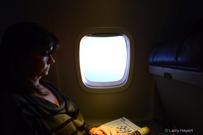 Woman Doing Crossword Puzzle At 36,000 Feet