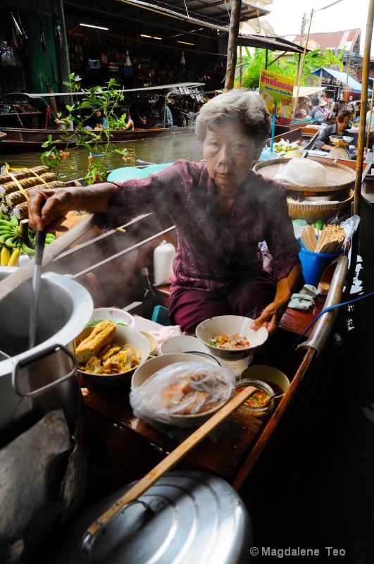 Lady cooking @ Floating Market, Bangkok Thailand