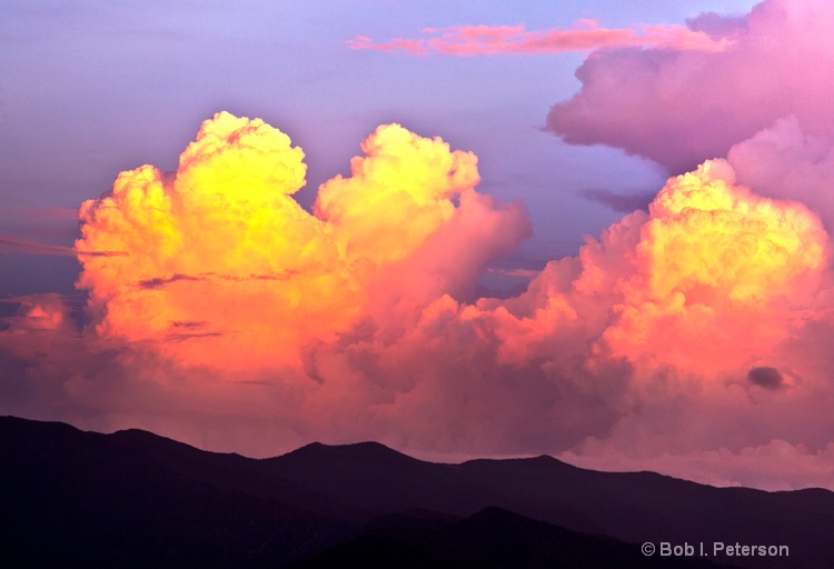 sun sets on thunderheads