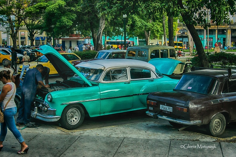 Working on a car in Old Havana, Cuba