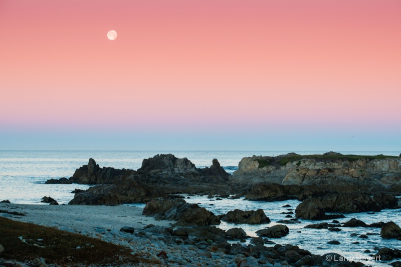 The moon sets in Pacific Grove, CA