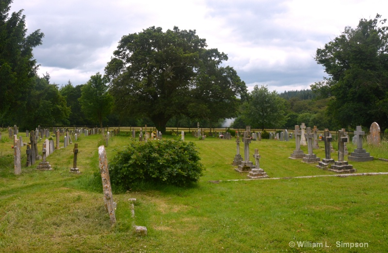 AT THE FAREST END OF THE GRAVE YARD