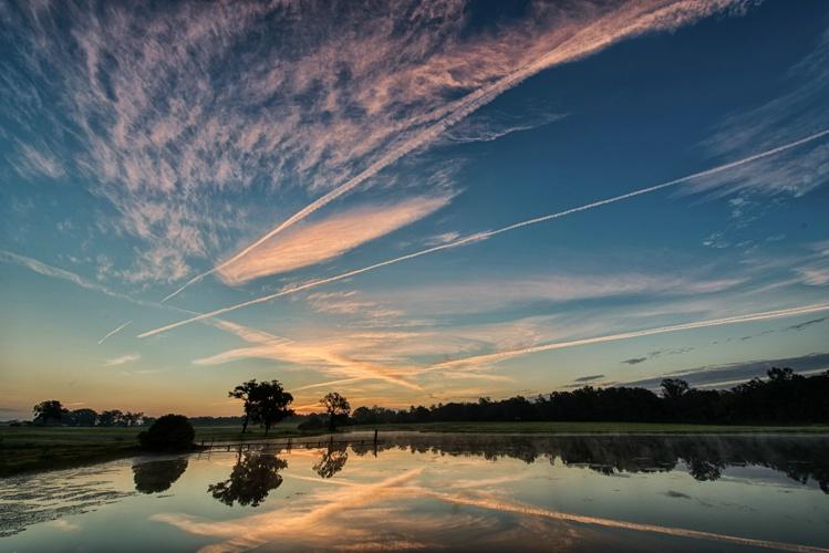 Con trails at dawn