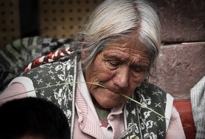 Old Woman Weaving