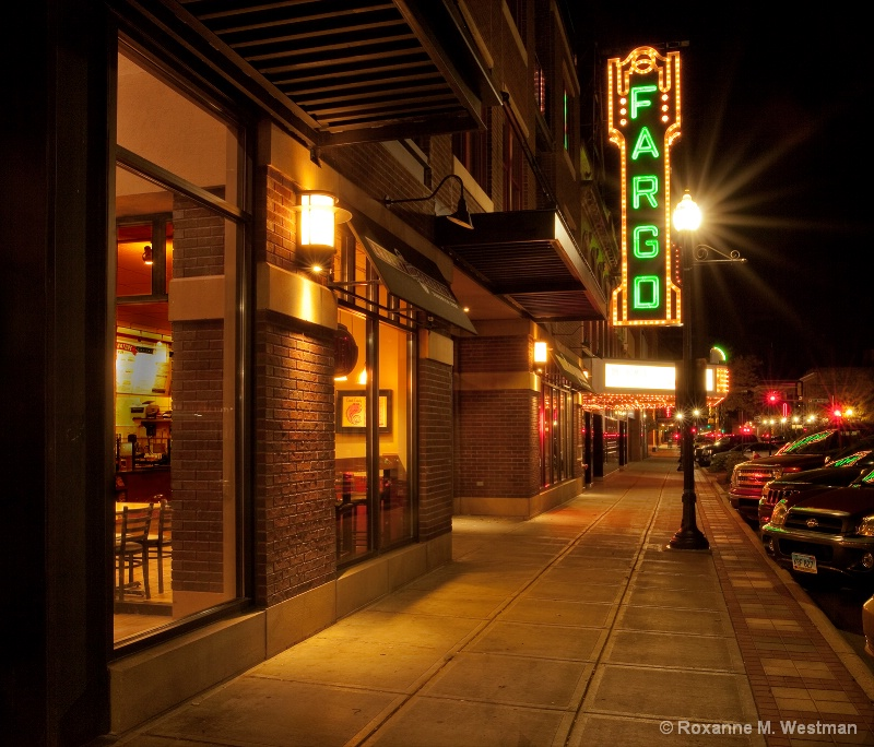 Walking the sidewalk to the Fargo theater