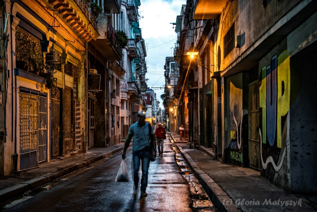 On the way to work before sunrise; Havana, Cuba