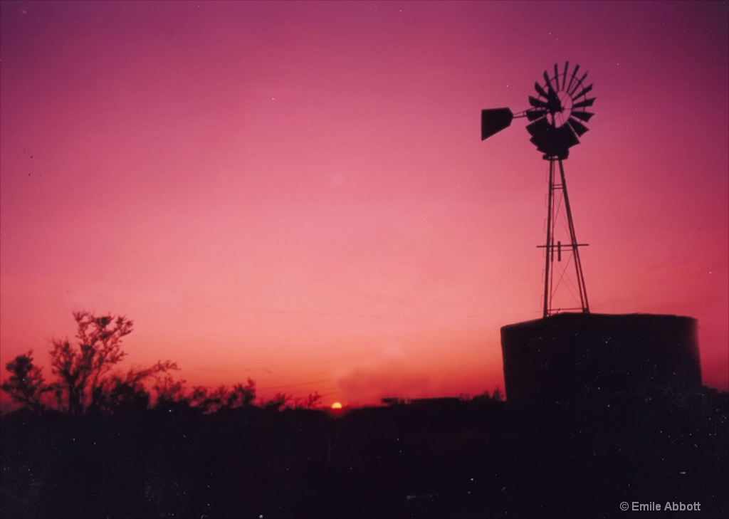 Texas tank and Windmill at sundown