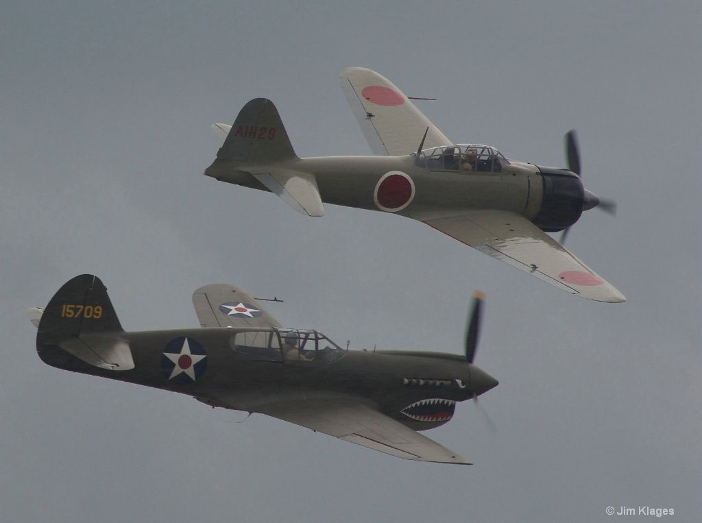 P-40E Warhawk and A6M2 Zero in Formation