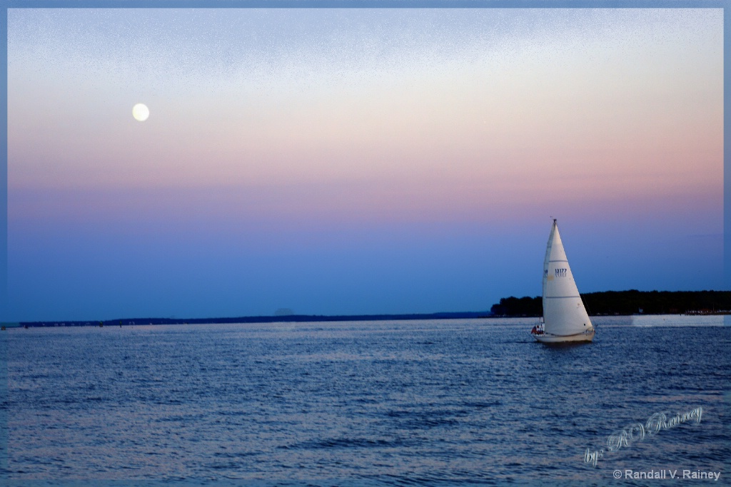 Tranquil Sail under the moon at sunset . . .