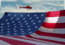 Composite of new sky, helicopter and flag