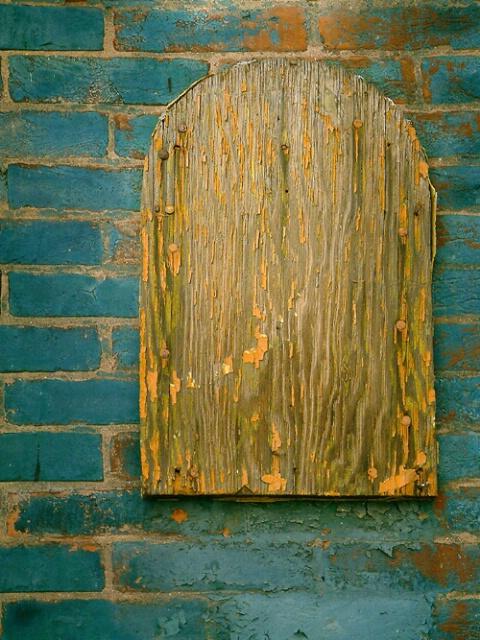 Old Wood on Painted Brick