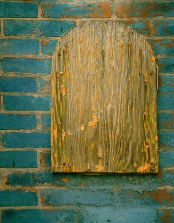 Old Wood on Painted Brick