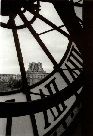 View of the Louvre through Musee D'Orsay cloc