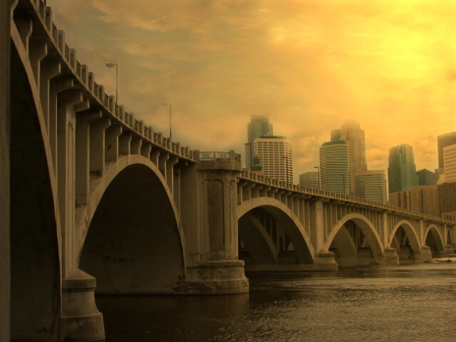 Golden Glow On Stone Arch Bridge