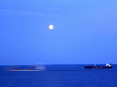 Phantom Ship Passing Under Moon