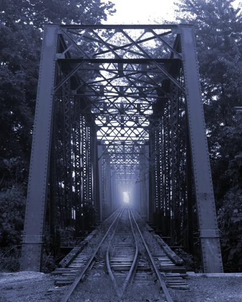 Railroad Bridge In Fog
