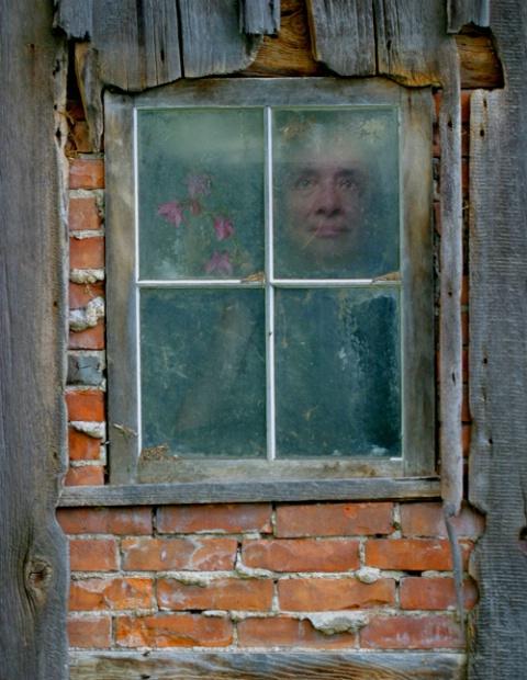 Self Portrait in Barn Window