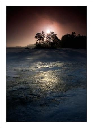 Light over the frozen lake