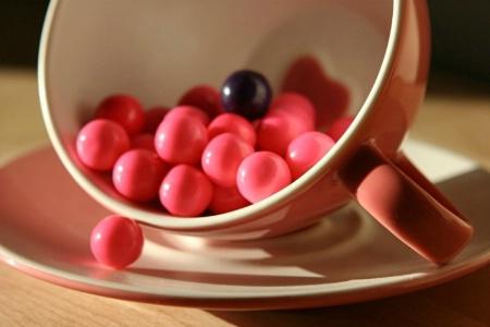 Teacup full of pink, purple & white