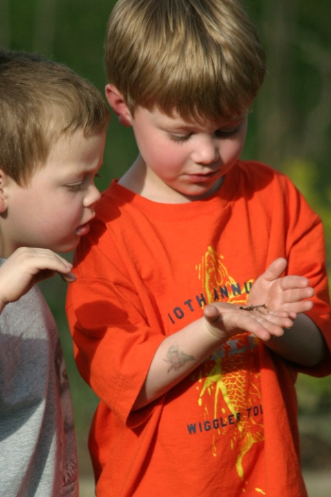 My Grandsons playing with a worm.