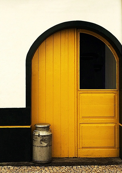 The milk can and yellow door