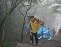 Chinaman carrying heavy load