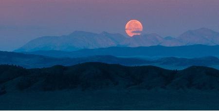 Full Moon Over the Peaks