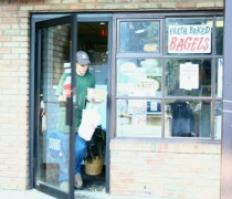 Customer Leaves Bagel Giant With Bagel and Coffee