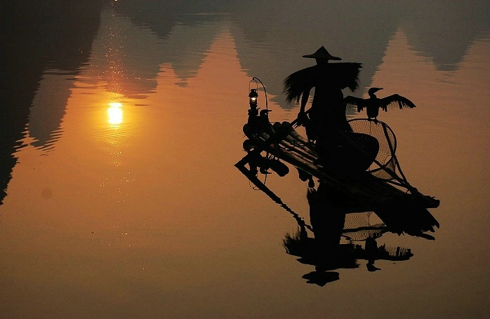 Fisherman under Sunrise