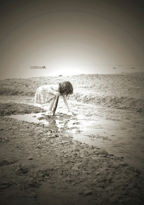 girl collecting rocks