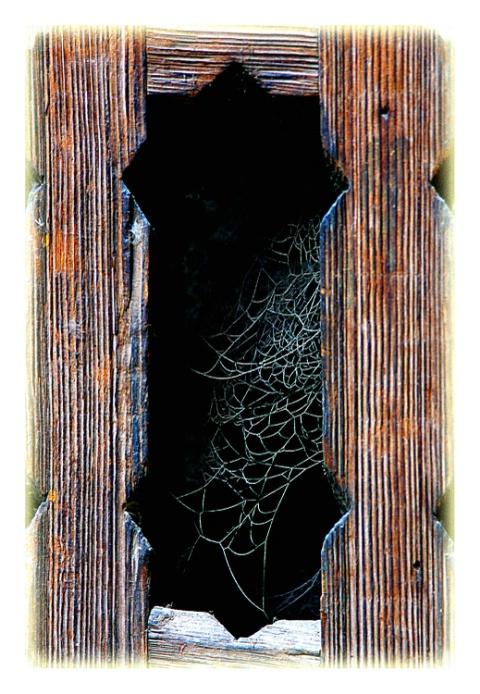 wooden motif in basement window