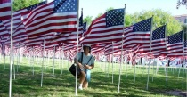 Kneeling by the Flags
