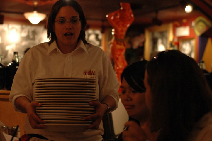 Waiter carrying the Plates