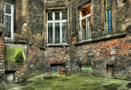 a corner with orange child bicycle