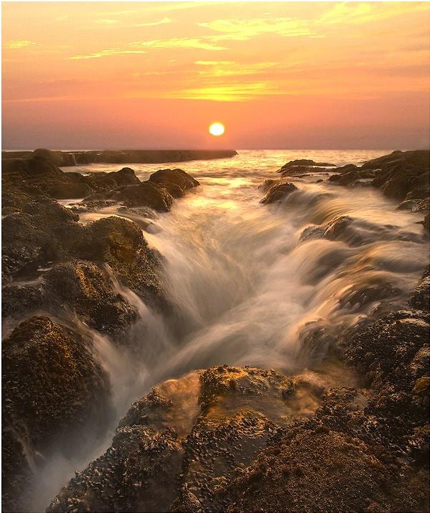 Waterfalls At Sea