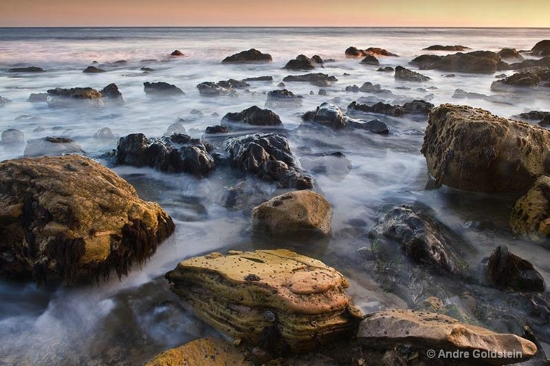 Surf and Rocks at Dusk