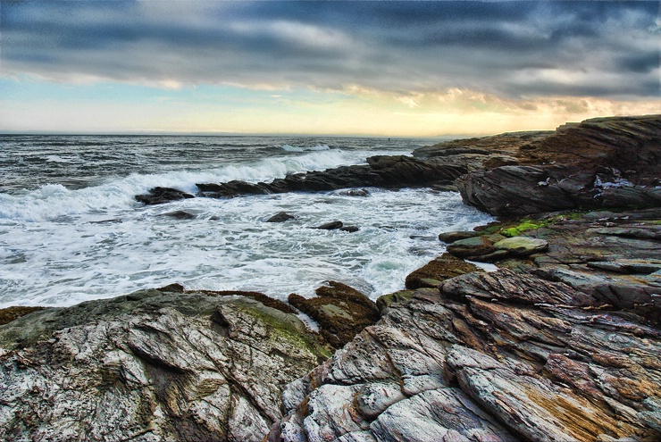 Weather over rocky shore