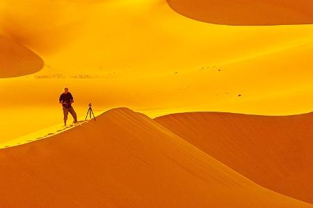 Photographer and sand